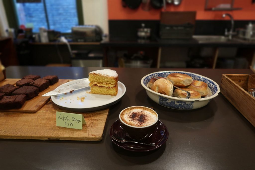 Photo of coffee and cake on a cafe counter