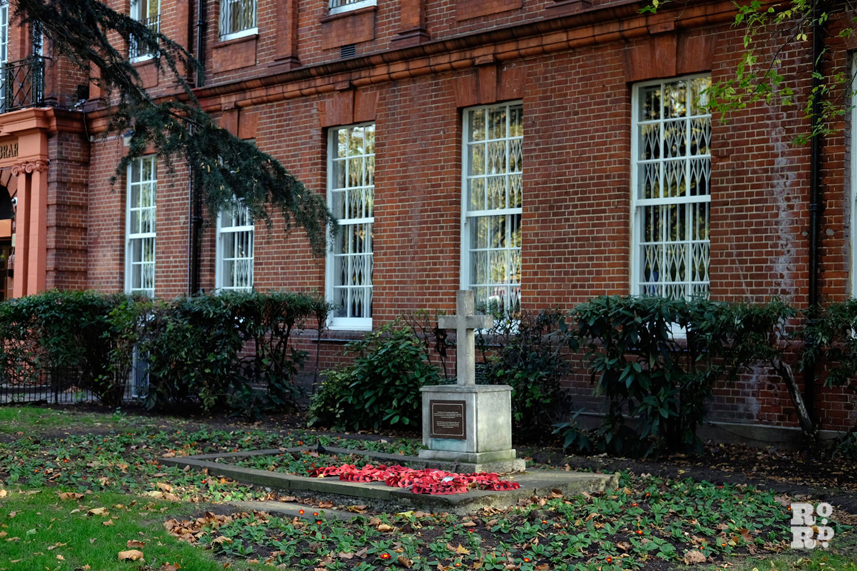 war memorial in front of a building
