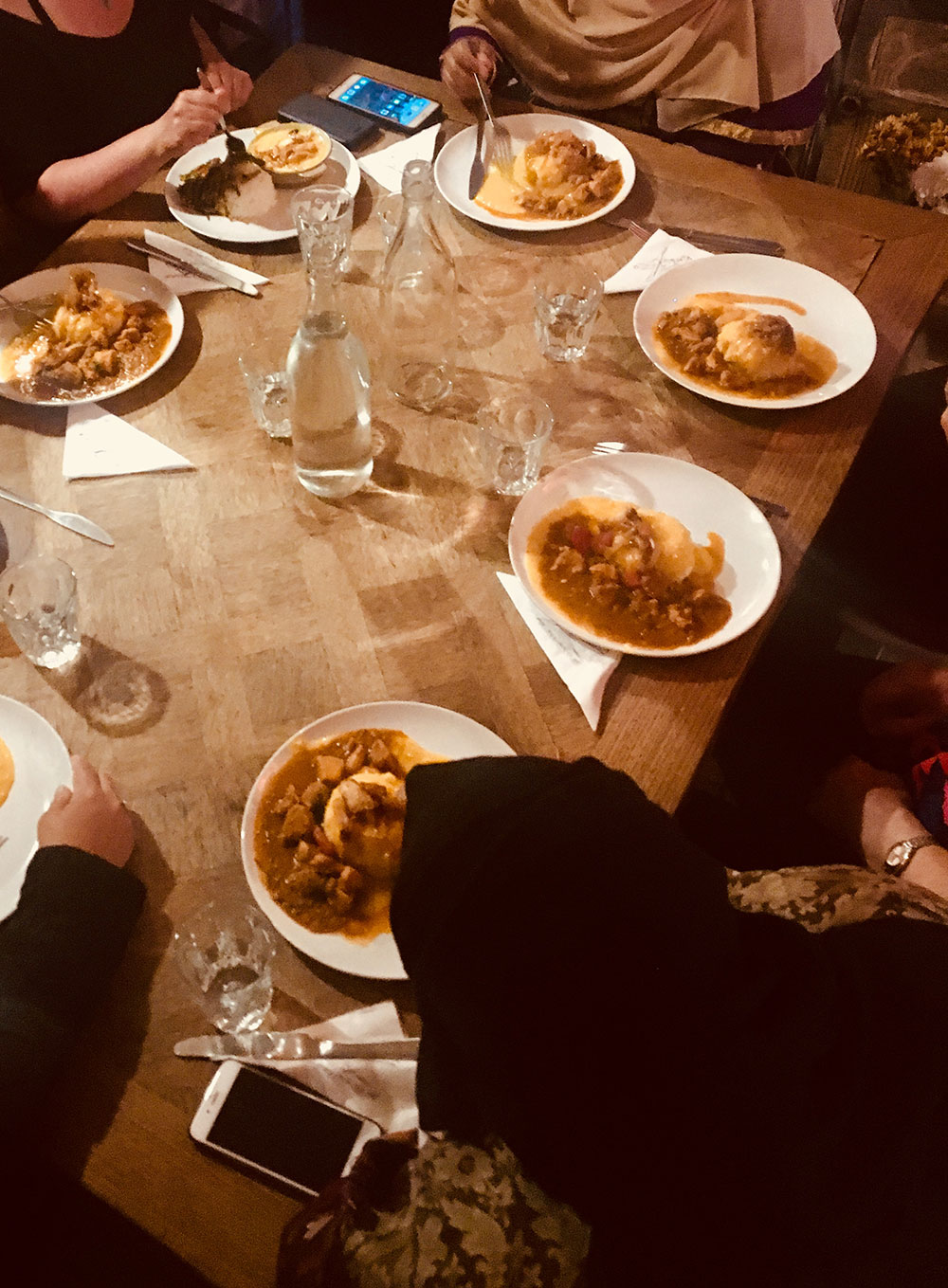 People around a table eating curry