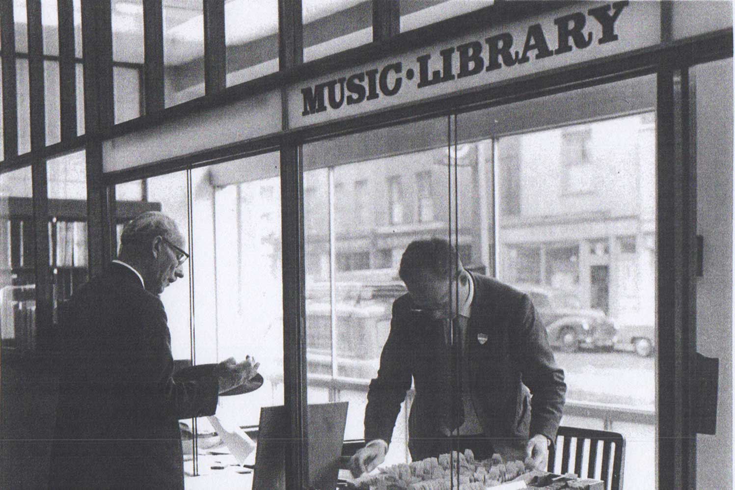 Two men browsing vinyls
