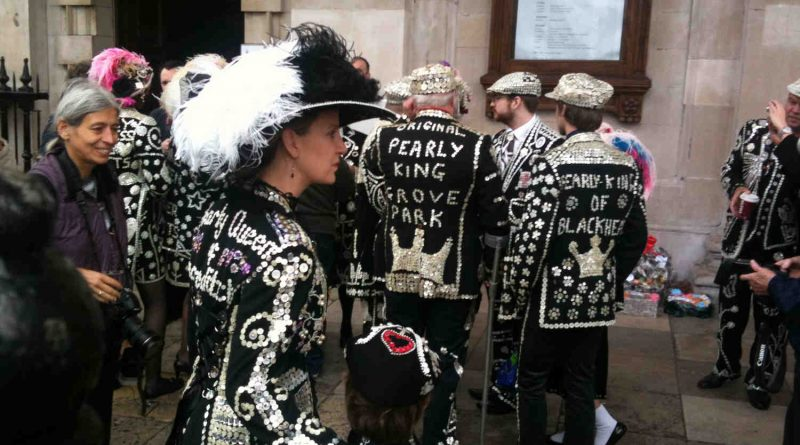 Pearly Kings and Queens of Blackheath and Grove Park standing on street