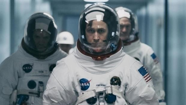 Ryan Gosling in astronaut suit walking through corridor