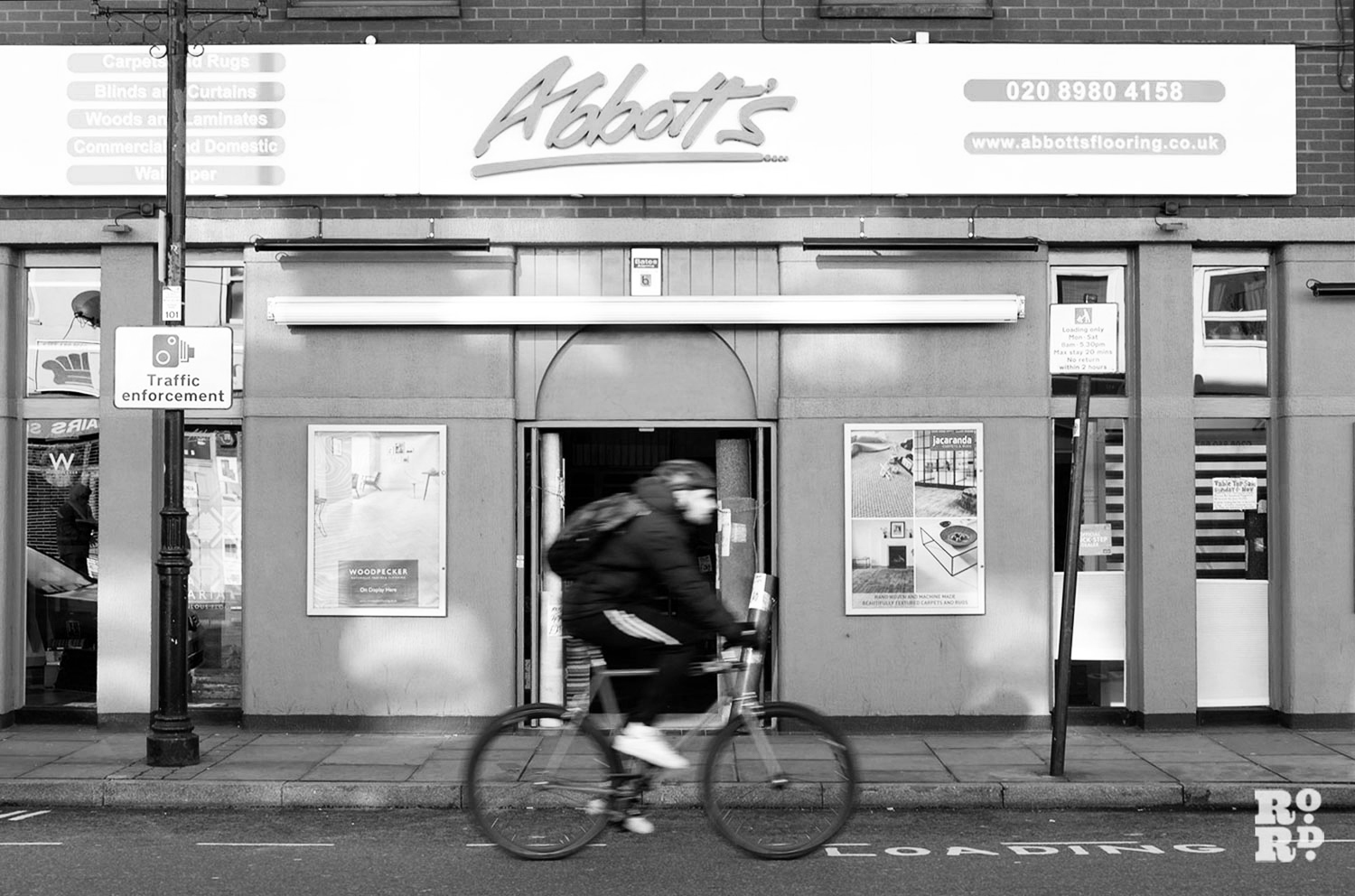 shopfront with a cyclist passing by