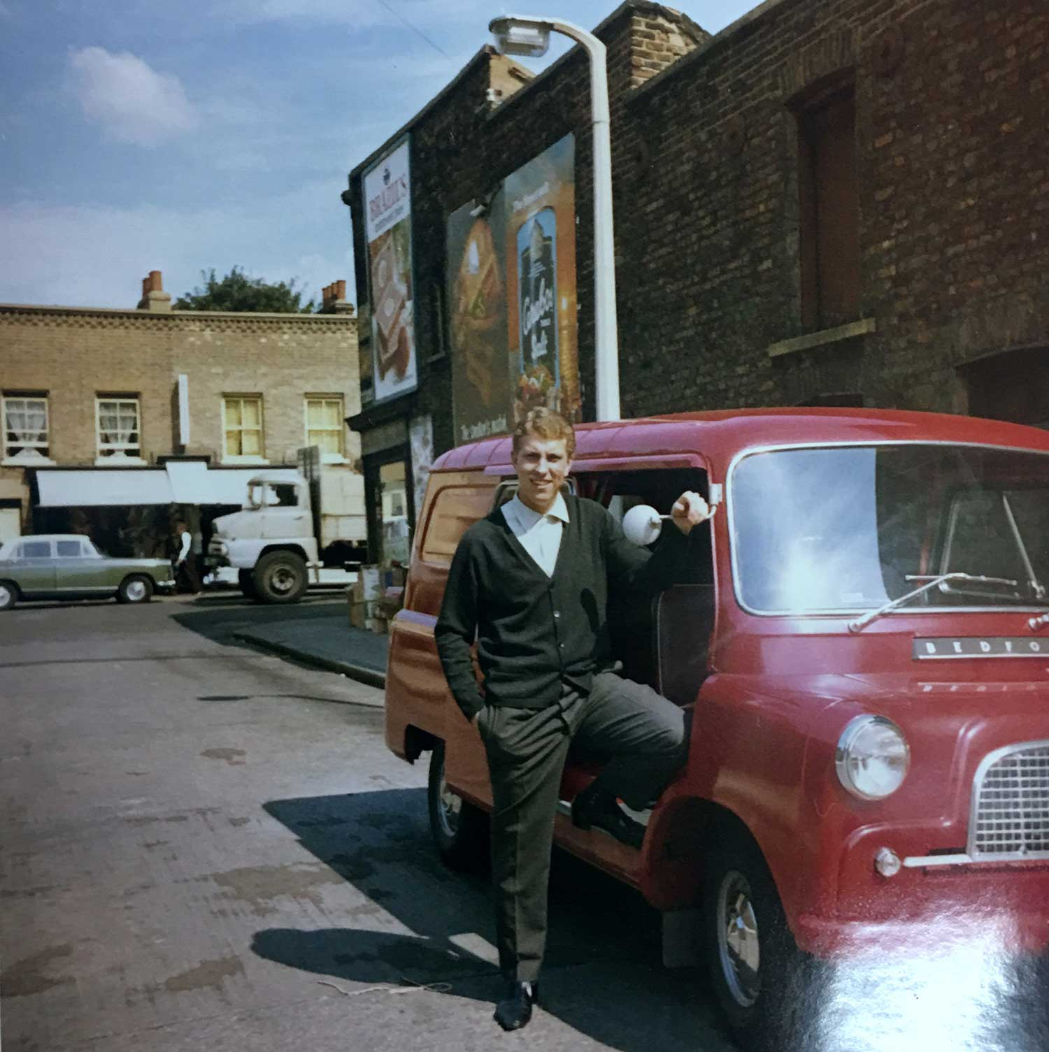 a man and a red van