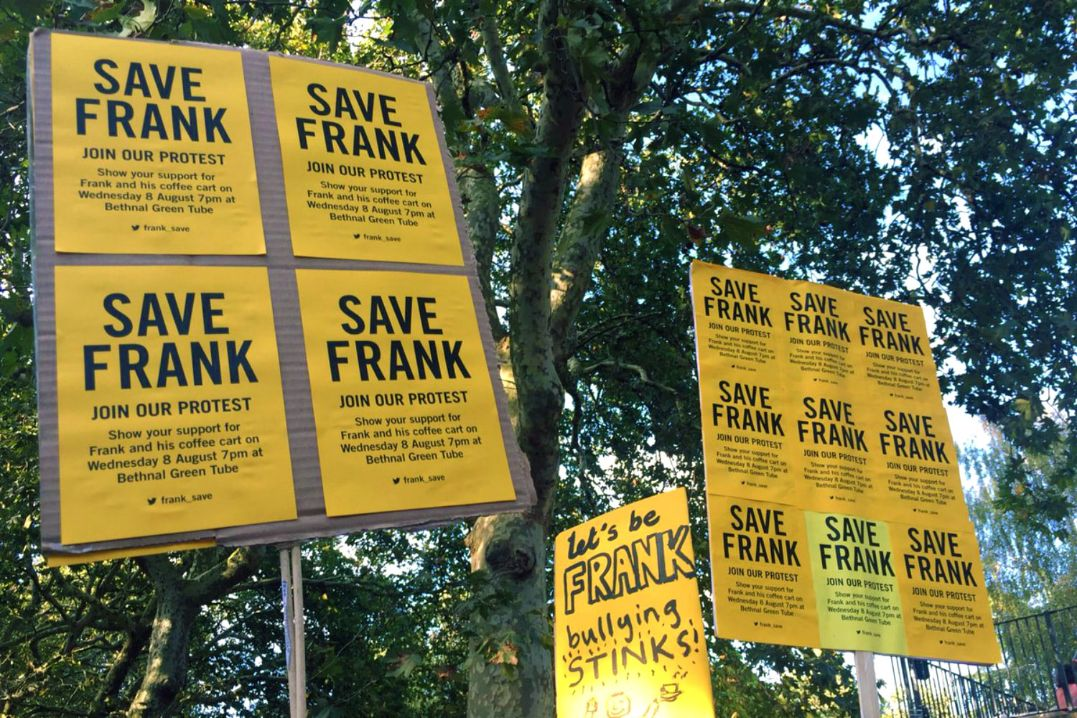 Pro-Frank Wang signs at an August demonstration in Bethnal Green