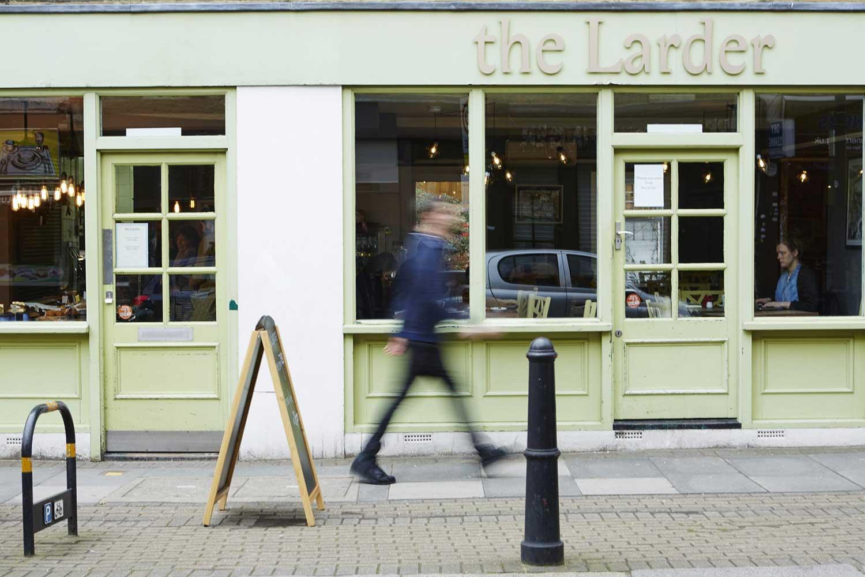 Green shopfront of The Larder vegan cafe in Globe Town, East London