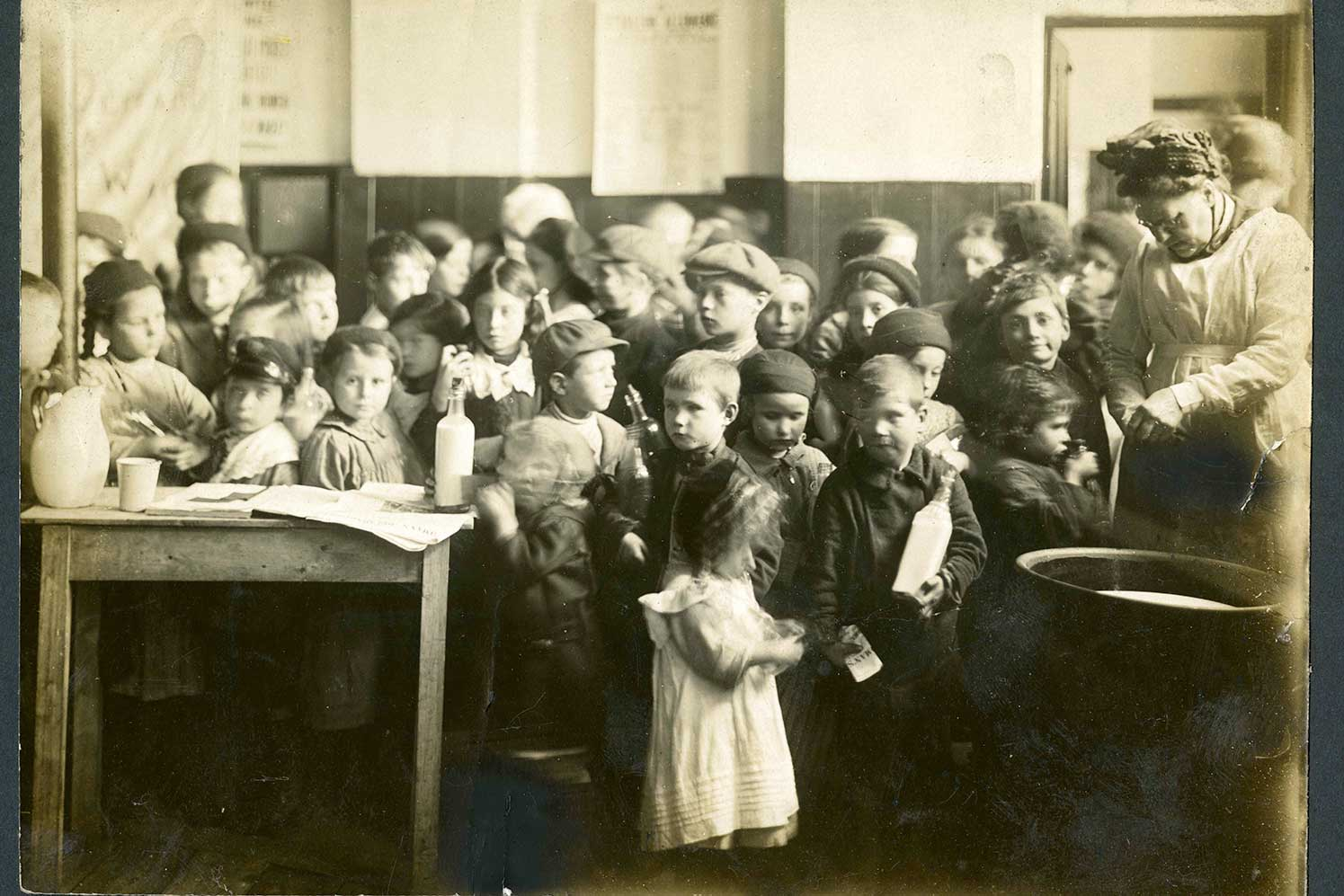 black and white image showing school children