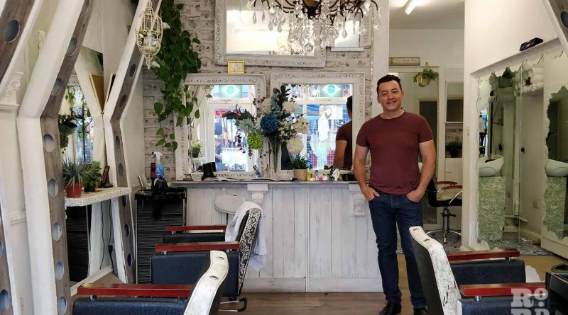 Owner Adi standing inside Creations, Roman Road, Bow