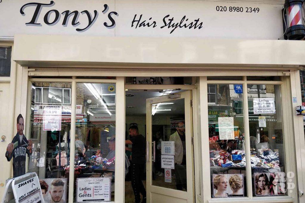 The front of Tony's hairdressing salon on Roman Road, Bow