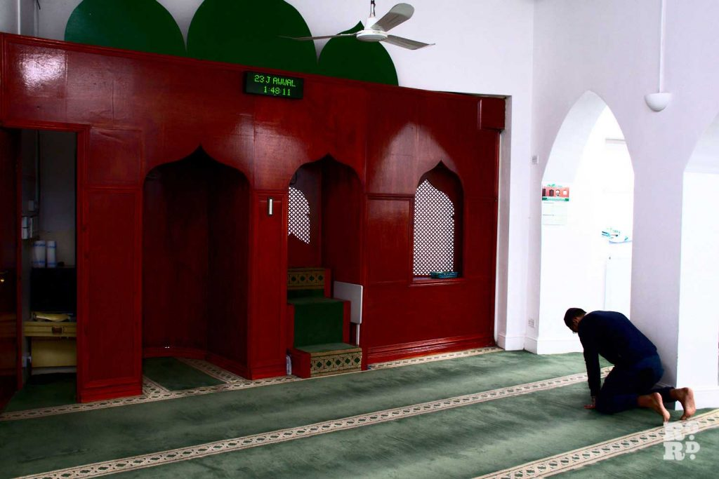 A man praying in the Bow Muslim Community Centre