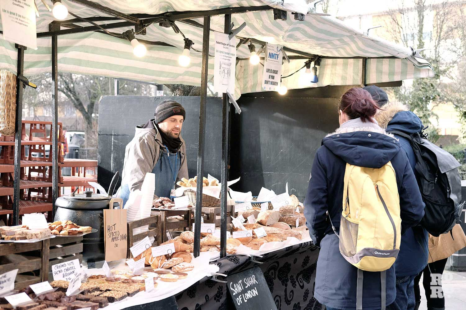 Roman Road market goers browse the Saint Sugar of London selection