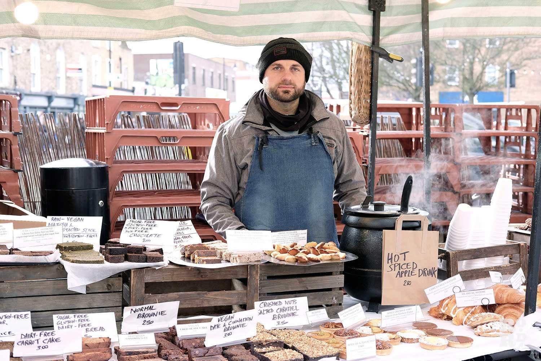Enzo tending his Saint Sugar of London stall on Roman Road