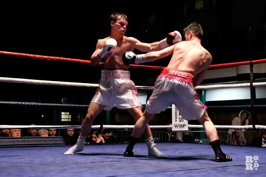 Louis Isaacs and Rhys Saunders exchange blows in the ring at York Hall