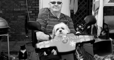 Chris Kimberley and his dog, Skye, outside their home in Bow, East London