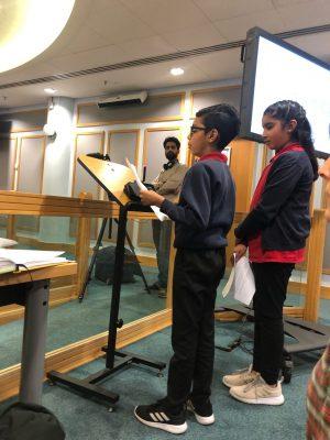 Tower Hamlets schoolchildren Usma and Zain present a climate emergency petition