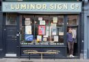 Ged Palmer, standing in the doorway of his shop on Roman Road Luminor Sign Co
