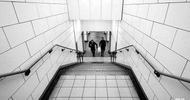 couple walking up tiled stairs of mile end tube station