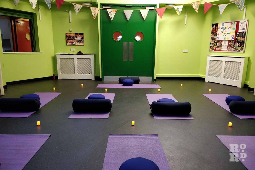 Paul's yoga mats set up in Cranbrook Community Centre