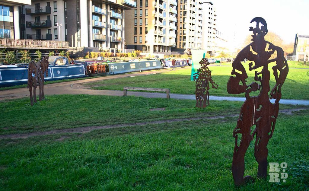 Tow path statues in Mile End Park. Statues, monuments Tower Hamlets.
