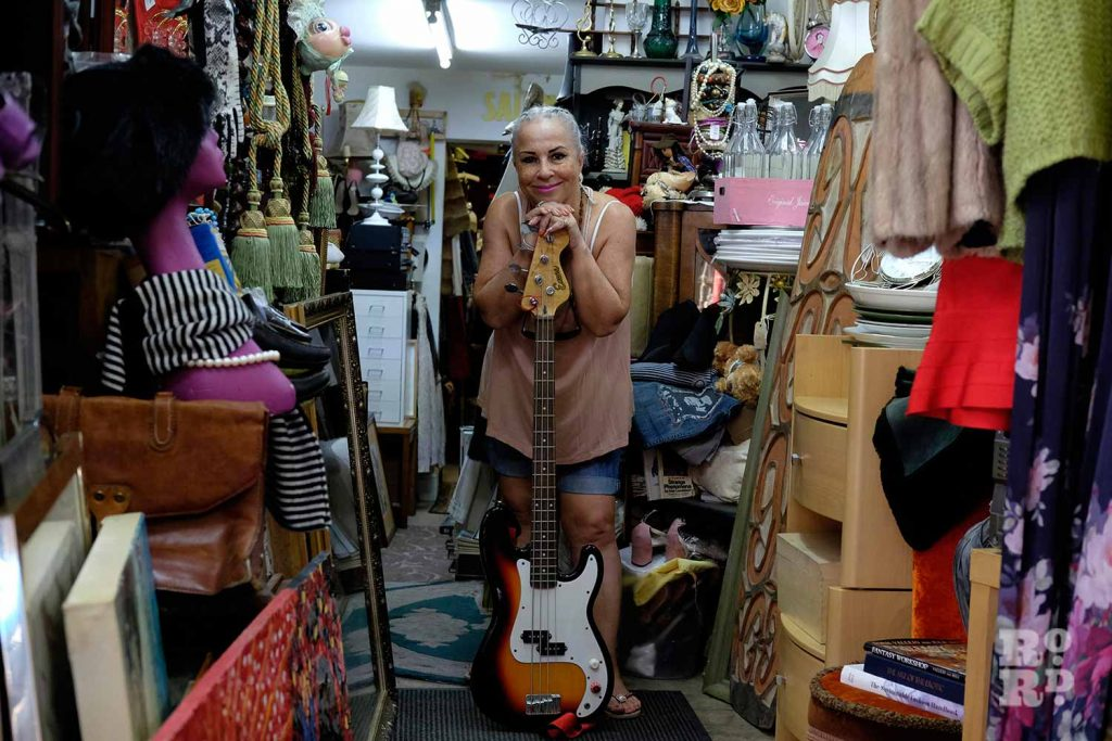 Gina in Gina's Closet with bass guitar