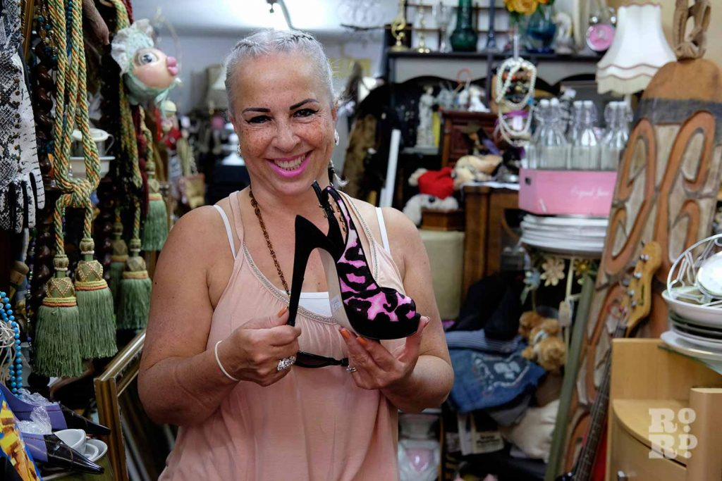 Gina in Gina's Closet holding high heel