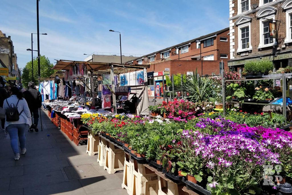 A flower and clothes stall at Bethnal Green Road Market, East London