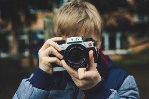 Boy holding camera