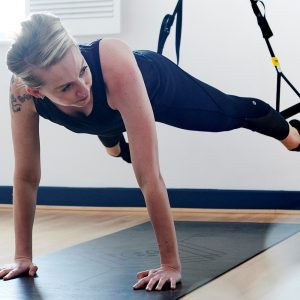 Yoga and fitness class using TRX suspension training
