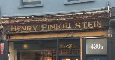 Old sign of Henry Finkelstein on Roman Road