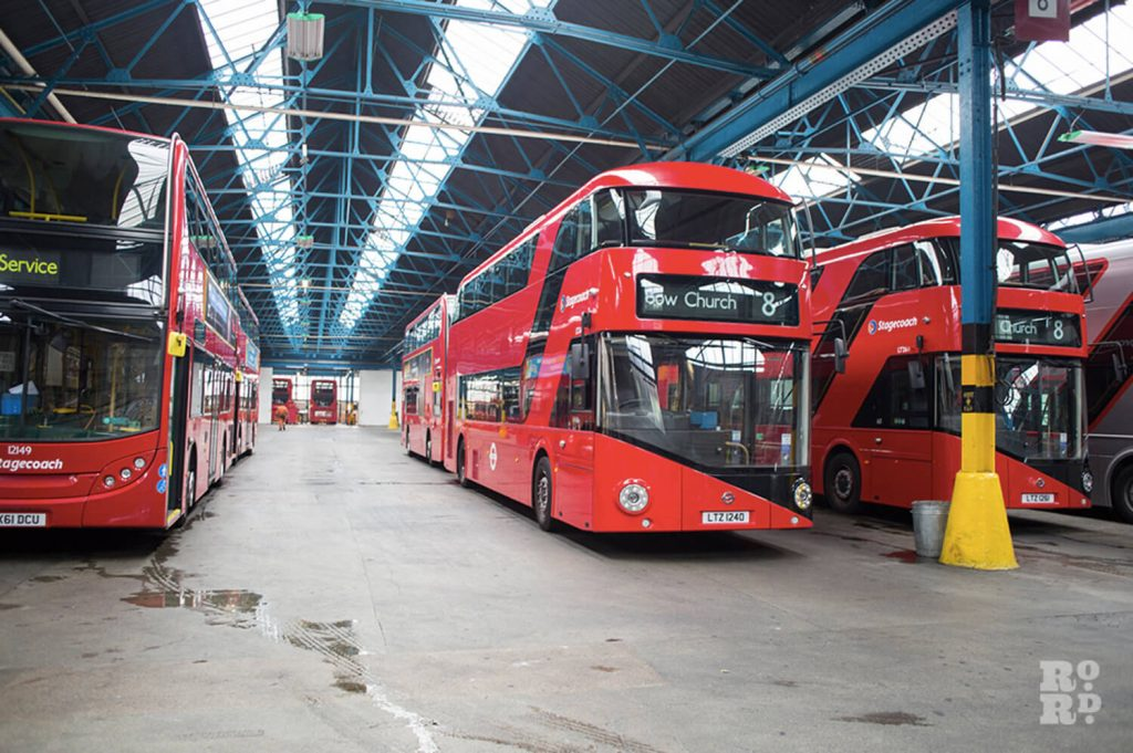 Red double deck no 8 London bus inside Bow Garage East London