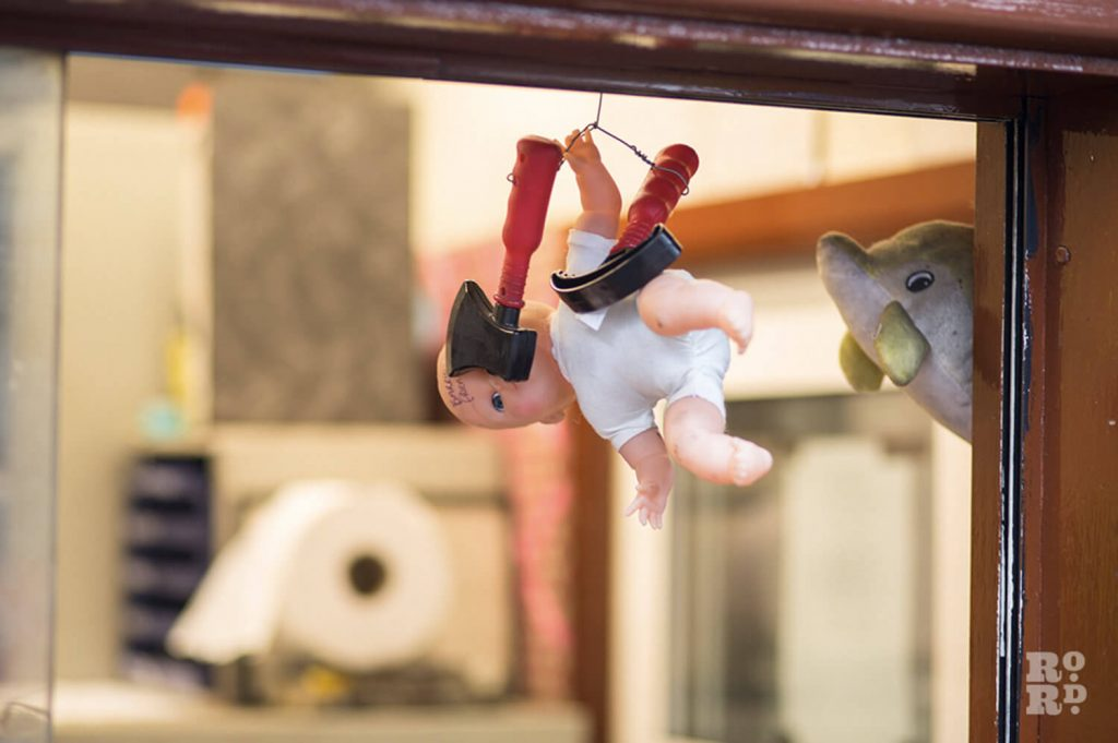 Toys hanging from ledge