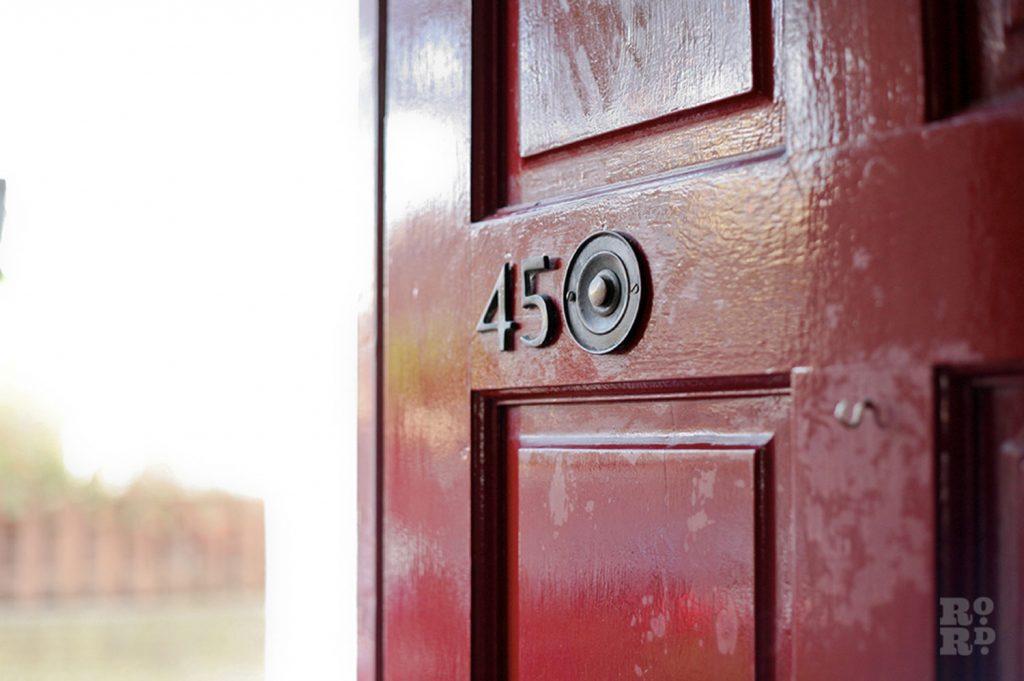 The red front door of 45 Grove Road