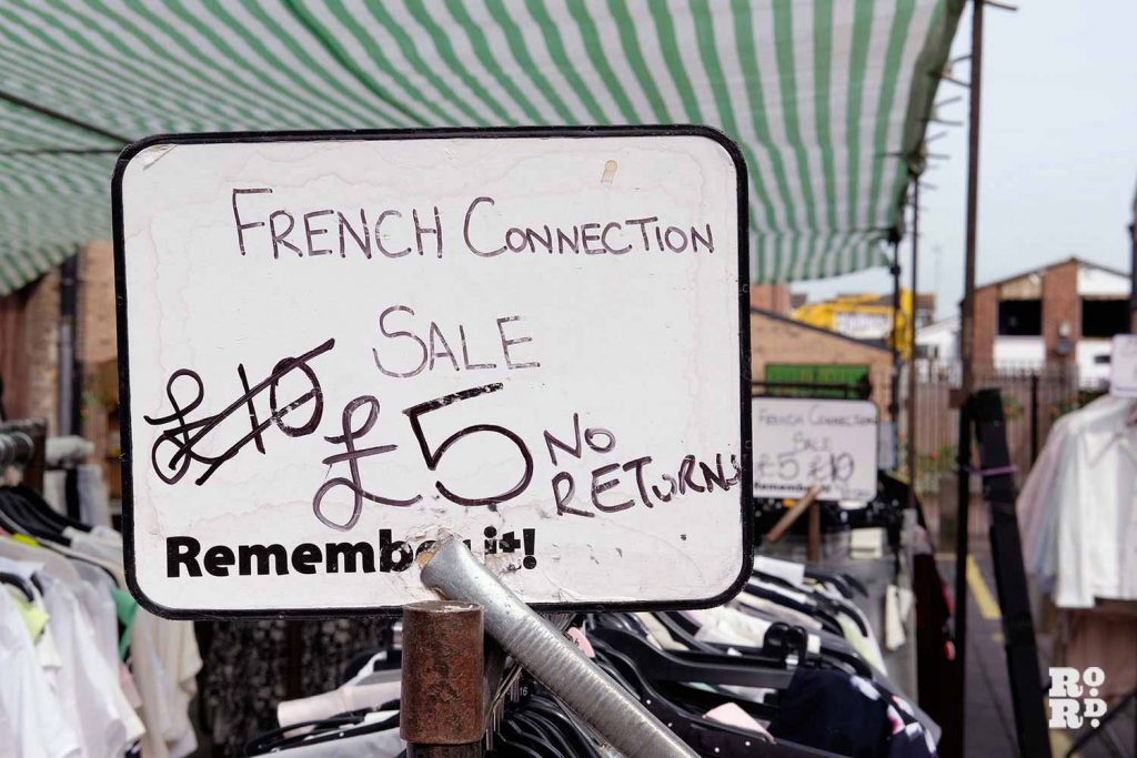 French connection sale sign on a stall at Roman Road Market