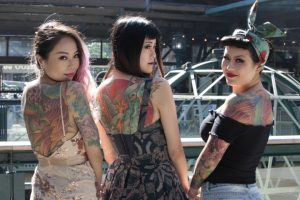 Three women at the London Tattoo Convention