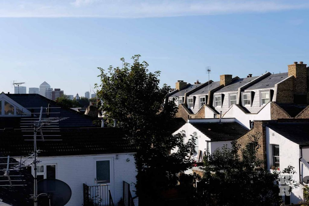 Valleys of butterfly roofs visible at the back of mansard roofs in Bow