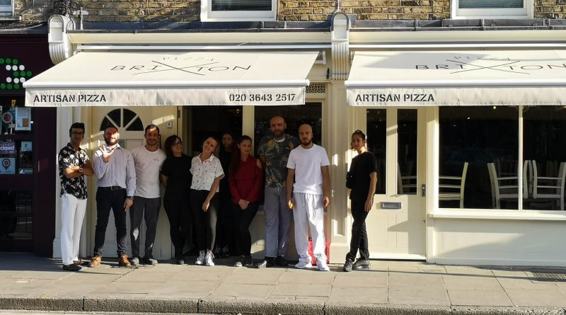Staff outside the newly opened Pizza Brixton @ Bow