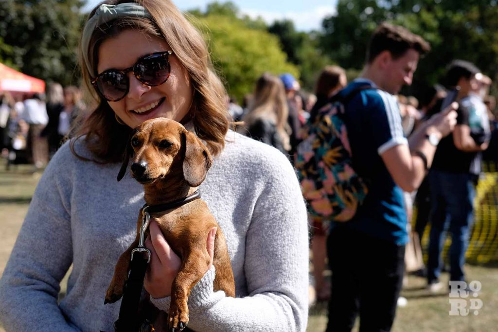 Woman holding dog at the Victoria Park Dog Show