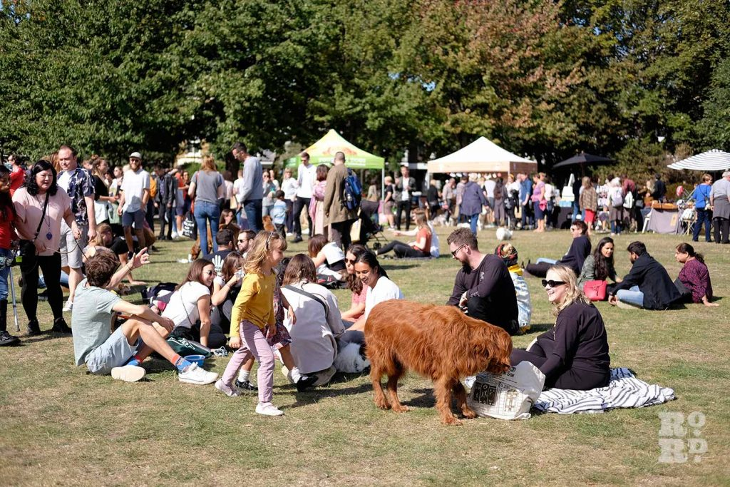 Dogs and their owners resting at the Victoria Park Dog Show