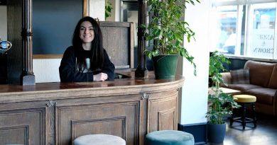 Melise Keogh standing behind the bar at Angel and Crown pub, Roman Road