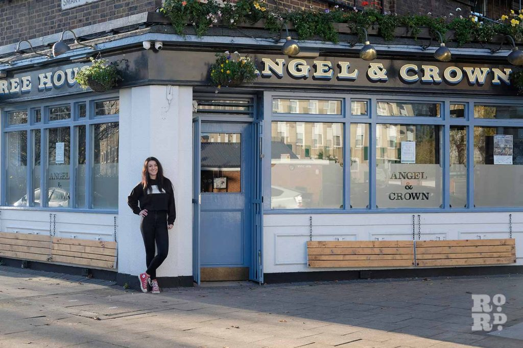 Melise Keogh standing outside the Angel and Crown pub on Roman Road