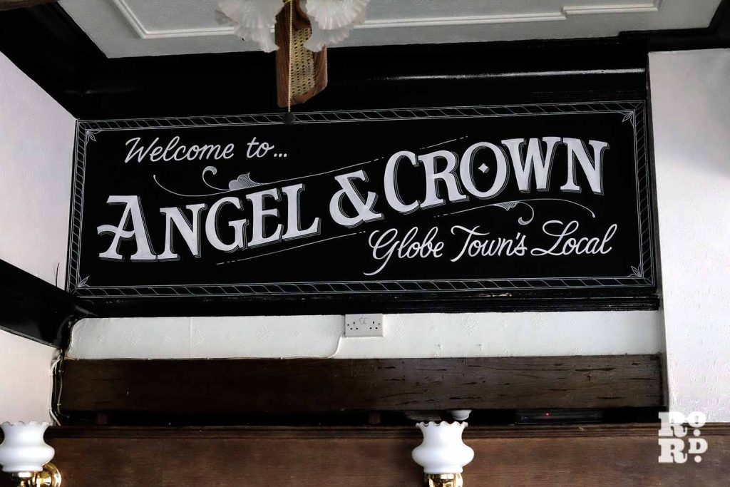Signage inside Angel & Crown pub on Roman Road, painted by Luminor signwriters