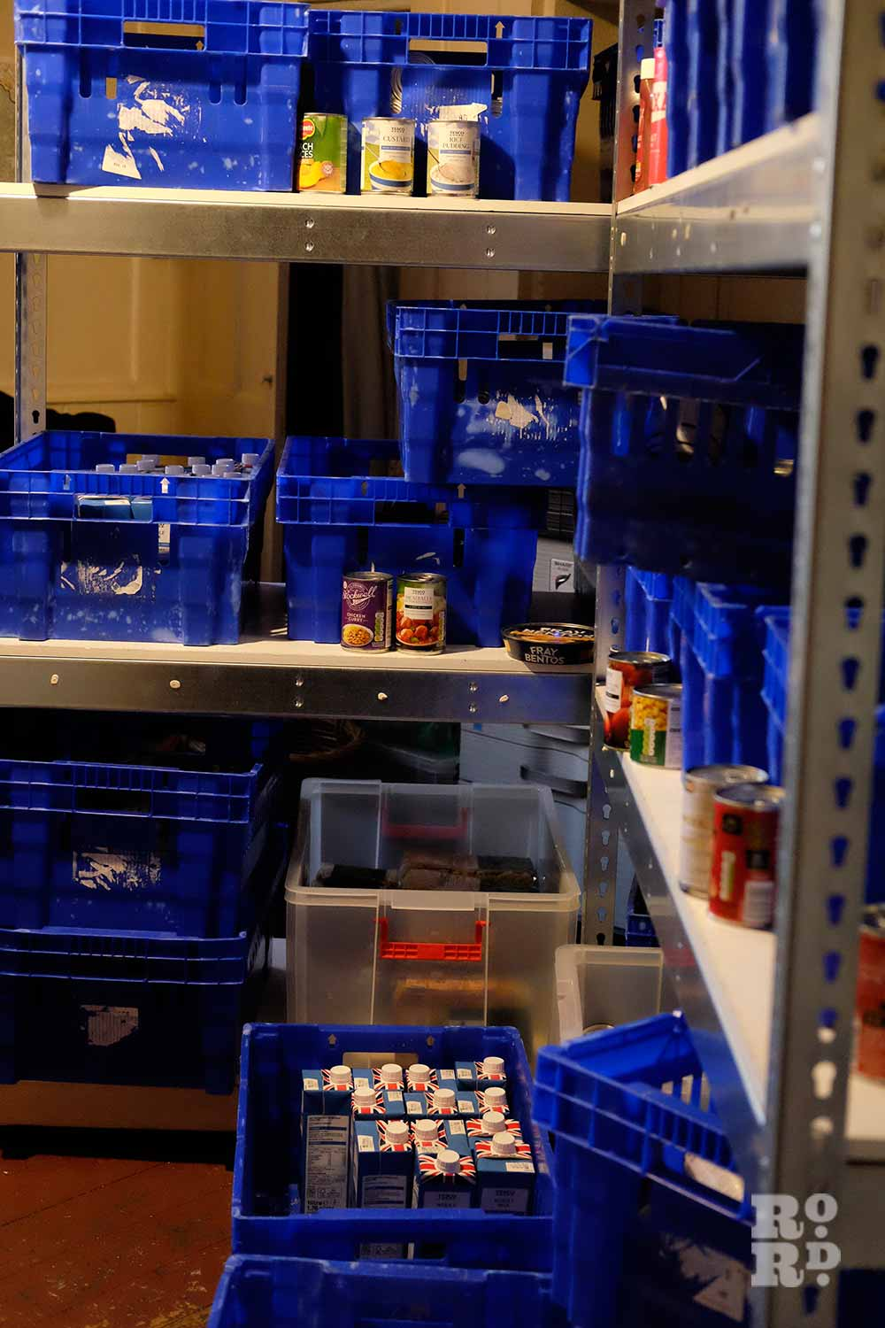 Blue crates storing food at Bow Food Bank, East London