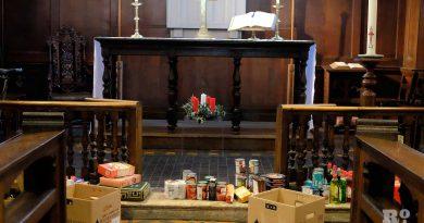 Food at the church alter at Bow Food Bank, East London