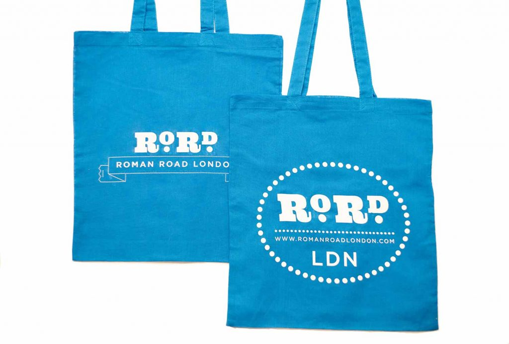 Back and front of cyan blue Roman Road LDN shopping top bag.