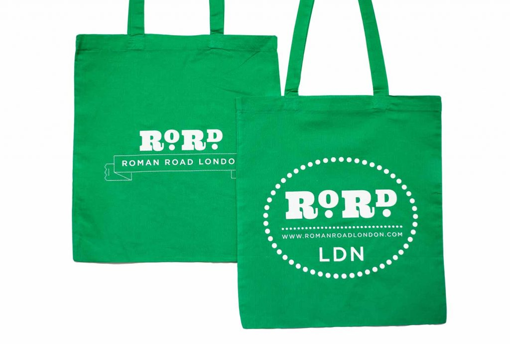 Back and front of green Roman Road LDN shopping top bag.