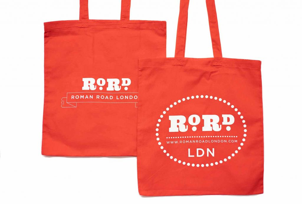 Back and front of red Roman Road LDN shopping top bag.