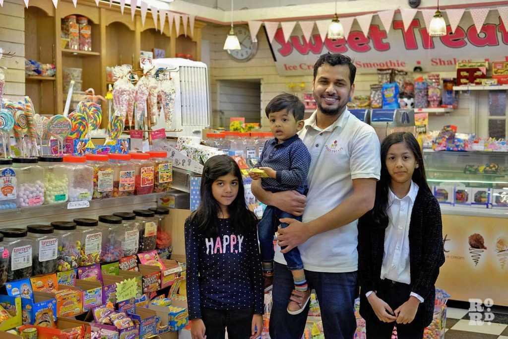Naz, owner of Sweet Treats on Roman Road, with his family