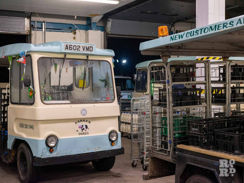 Milk Float parked inside Parker Dairies yard depot waiting to be loaded by milkman