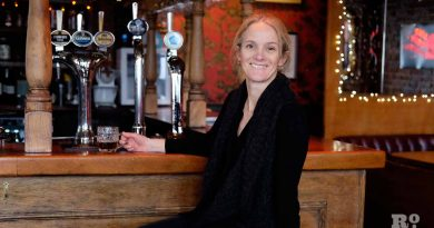 Claire Ashbridge Thomlinson founder of East London Brewery enjoying a half pint of Nightwatchman at The Florist pub