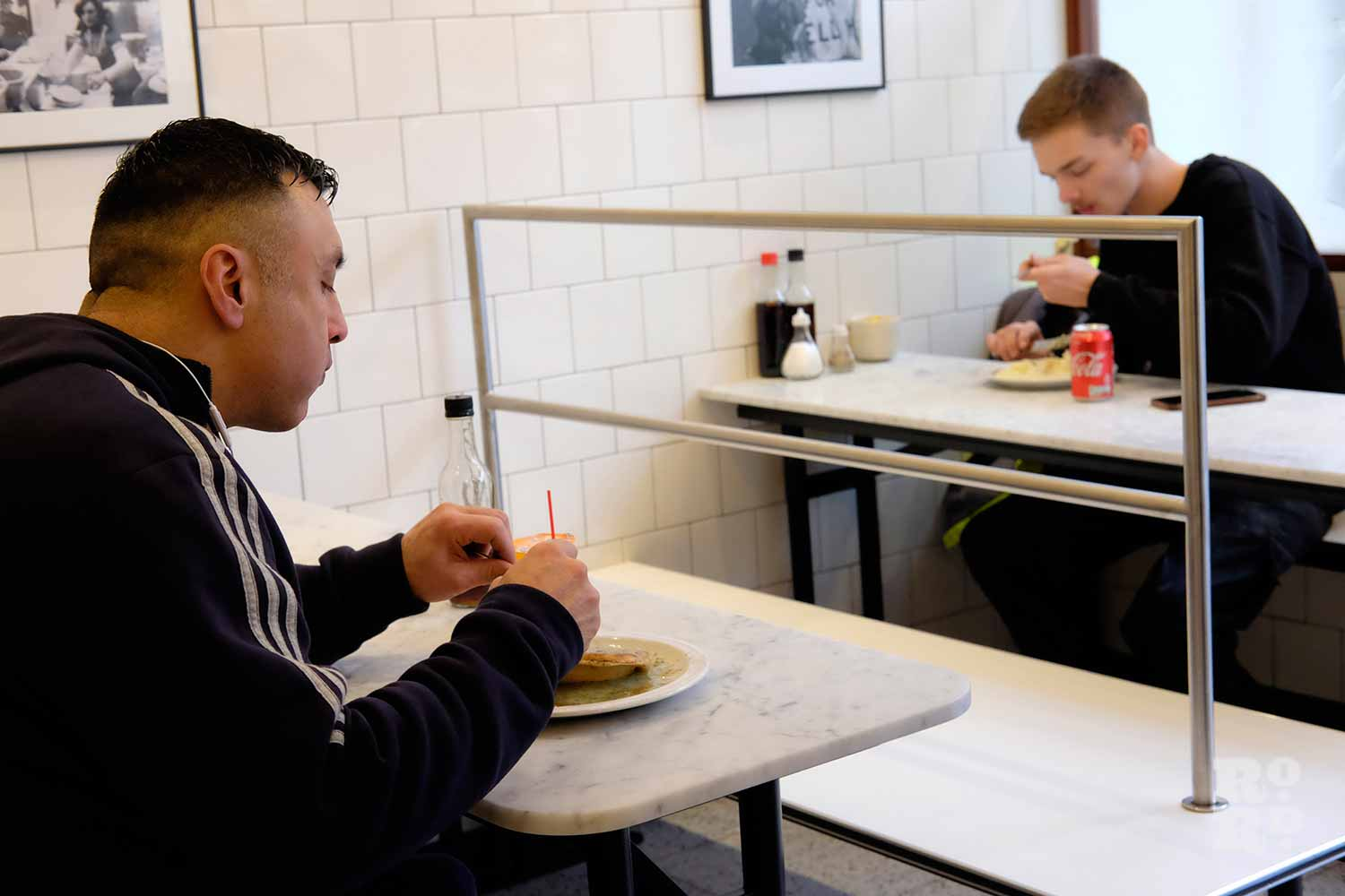 G.Kelly pie and mash Roman Road two customers eating